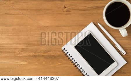 Top View Photo Of Workplace With Pen White Cup Of Coffee And Smartphone Display On Copybook Isolated