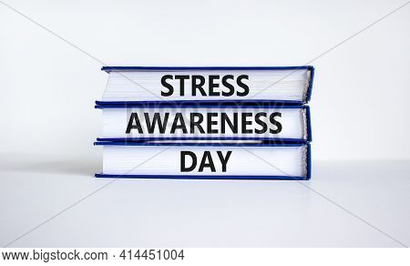 Stress Awareness Day Symbol. Books With Words 'stress Awareness Day'. Beautiful White Background. Ps