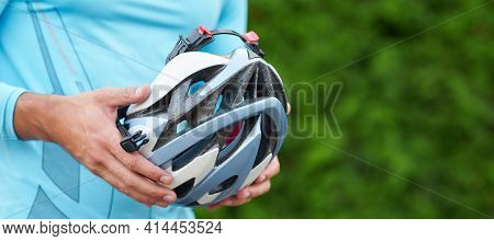 Website Header Of Cycling Accessories. Close Up Of Hands Of Male Cyclist In Sportswear Holding Bike