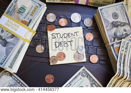 Student Loan Debt Concept With Borrowed Money On Laptop Keyboard Compounding In Interest Fees From H