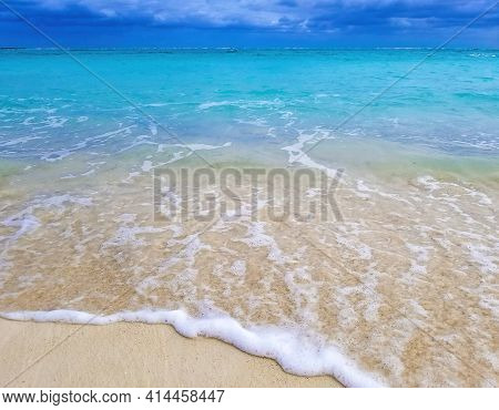 Tropical Bahamas Beach With Frothy Water Wave On Sand
