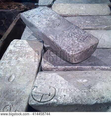 Close Up Of Silver Bar Ingots Stacked In A Pile With Engraved Medieval Characters
