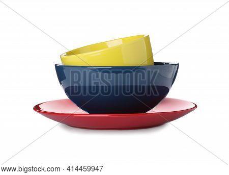 Stack Of Ceramic Dishware On White Background