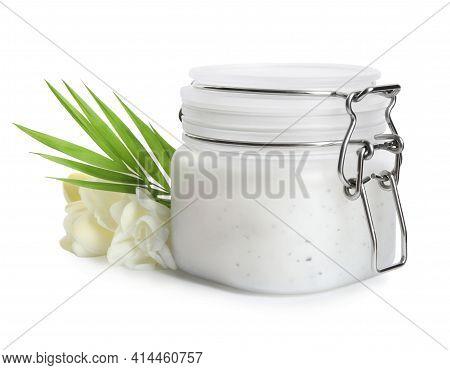 Jar Of Exfoliating Salt Scrub, Palm Leaf And Freesia Flowers On White Background