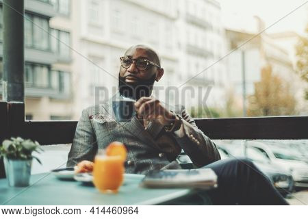 The Portrait Of A Handsome Stylish Wealthy African Guy With A Beautiful Black Beard, In Glasses, Bal