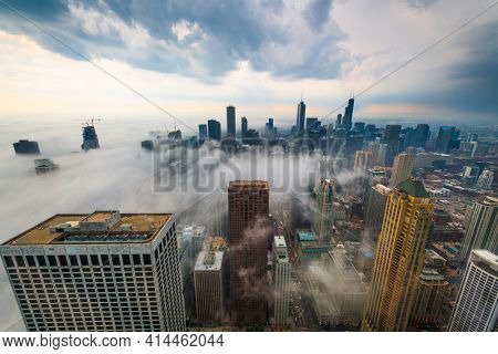 Chicago, IL, USA downtown cityscape with a fog rolling in.