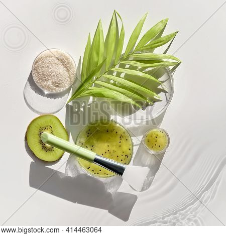 Cosmetic Skincare Background. Herbal Medicine With Kiwi Slices And Palm Leaves. Homemade Self Made S