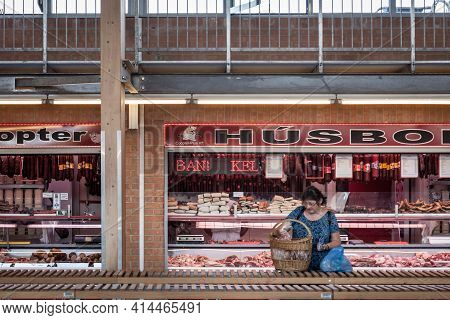 Szeged, Hungary - July 21, 2017: Woman Packing Food In Front Of A Butcher Shop (husbol) In Szeged Co