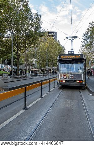 Melbourne, Australia - May 13, 2019: Classic City Tram Stopped At Station Along Swanston Street. Aff