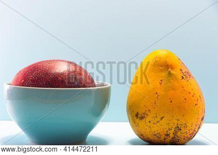 Fresh Pink Mango Fruit On Blue Background