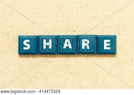 Tile Alphabet Letter In Word Share On Wood Background