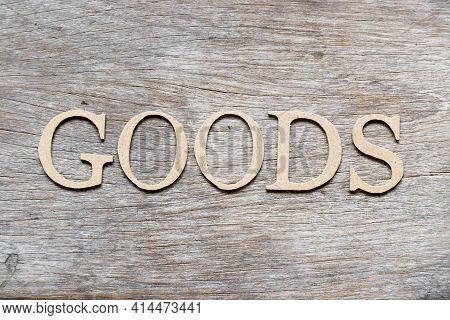 Alphabet Letter In Word Goods On Wood Background