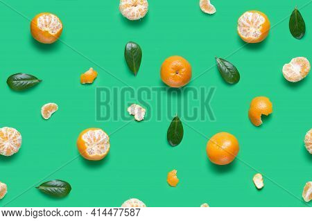 Isolated Mandarin Pieces On Green Background. Tangerine Orange Seamless Pattern. Flat Lay Of Whole A