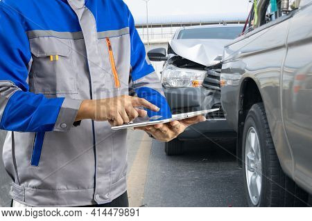 Insurance Officer Writing Clipboard And Examining Check For Damage Car After Accident.