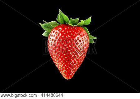 Ripe Juicy Strawberries On A Black Background In Close-up.