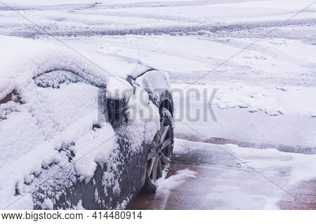 The Car In The Snow, Covered With A White Drift Of Snow.