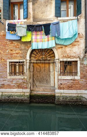 Small Canal In Venice With Clothesline And Laundry