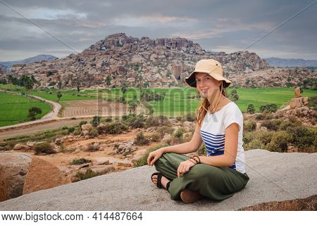 Tourist Woman Enjoying The Landscape Of Rice Field And Beautiful Hills Around Ancient Hampi City In
