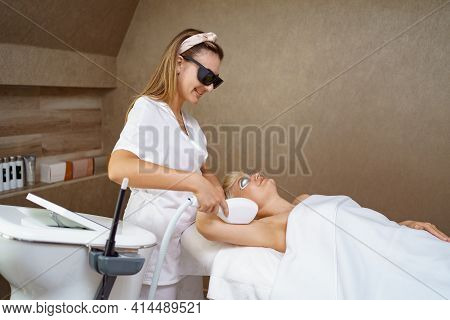 View Of Doctor Cosmetologist Doing Anti Aging Procedure In Cosmetology Office. Satisfied Woman In Di