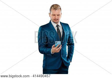 Man, Businessman In A Business Suit Holds A Smartphone In His Hands Is Isolated On A White Backgroun
