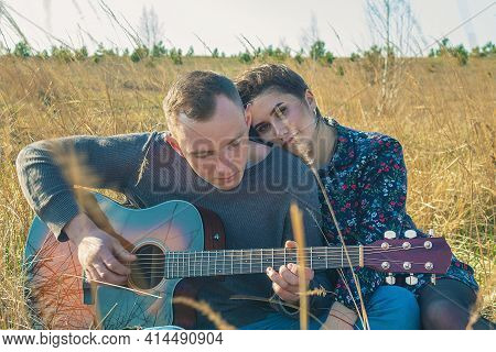 Man With A Guitar And A Girl Next Door. Rest Of The Lovers