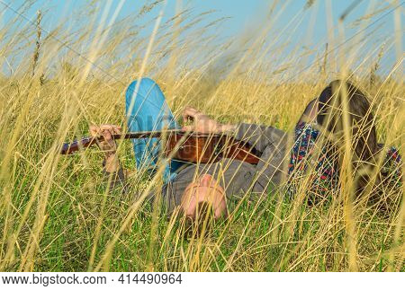 The Guy And The Girl Lie In The Grass. Guitar Play