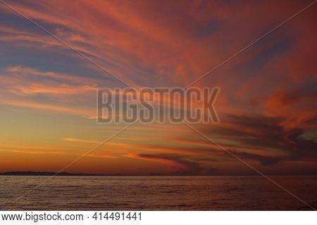 Dramatic Majestic Red Clouds After Sunset In Dusk On Lake Baikal, Beautiful Scenic Seascape, Dark Mo