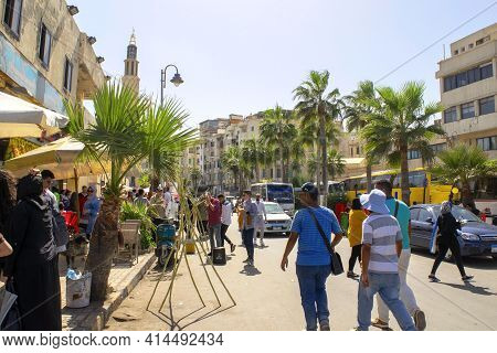 Alexandria - Egypt - October 08, 2020: Corniche Street During Feast Time With Many People. Crowded H