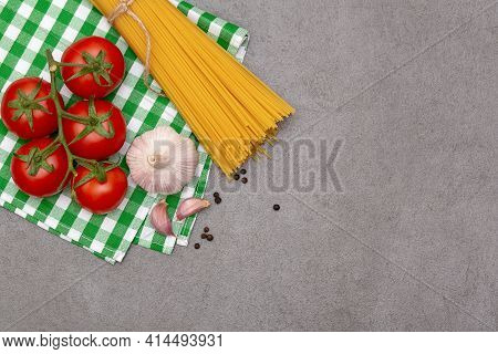 Spaghetti Ingredients And Vegatables On Grey Background Top View