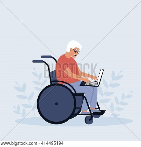 An Elderly Man In A Wheelchair Works On A Laptop. A Pensioner In A Wheelchair. The Concept Of An Acc