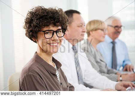 Portrait of business woman among her colleagues in the office