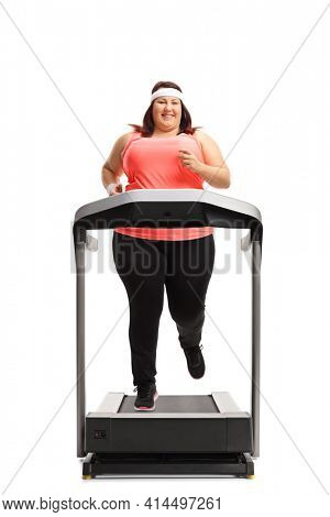 Full length portrait of an overweight woman running on a treadmill isolated on white background