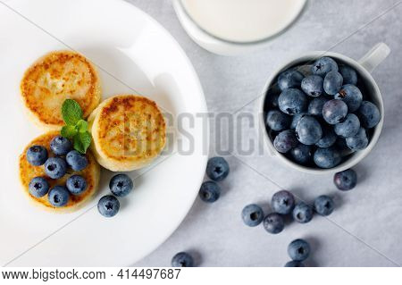 Cottage Cheese Pancakes, Syrniki With Blueberry In A White Plate
