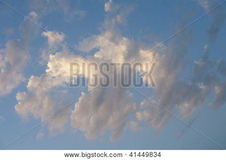 Sunlit Clouds In A Blue Sky
