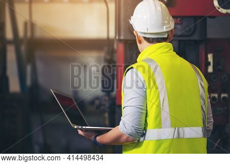 Engineer Man, Or Technicians Wearing Surgical Mask And Using Computer Notebook For Checking