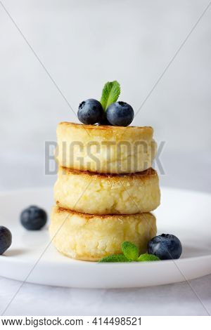Cottage Cheese Pancakes, Syrniki, Curd Fritters With Fresh Blueberries