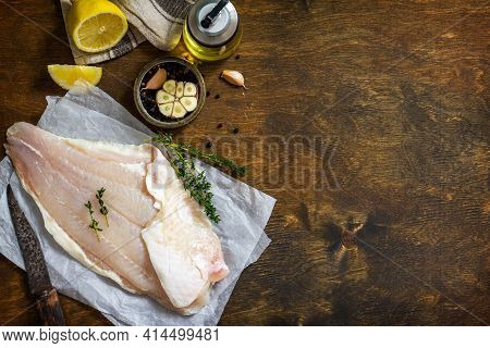 Seafood, Raw White Fish Fillet For Cooking. Fresh Fillet Pangasius With Spices, Lemon And Thyme On R