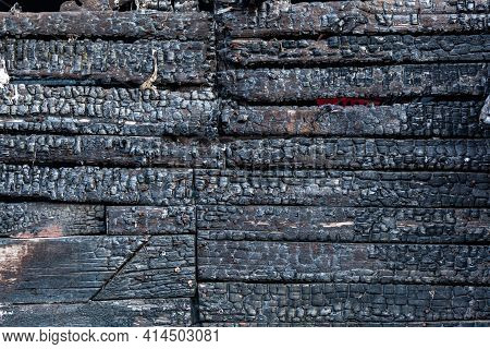 Burned Wooden Plank Background. Details Of Surface Of Charred Wood.