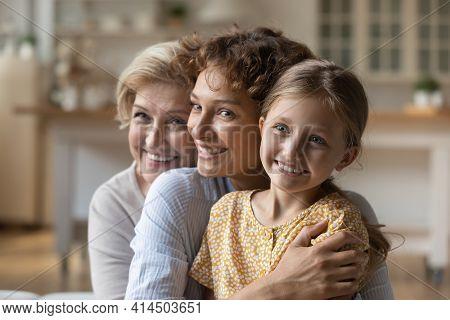 Happy Three Generations Of Women Hug Cuddle