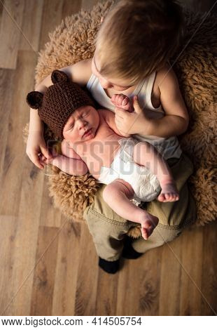 children brother and brother newborn baby