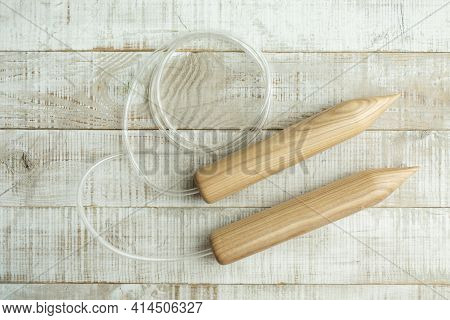 Thick Wooden Knitting Needles For Knitting Large Items With Merino Wool On A Wooden Floor