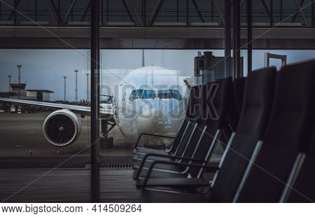 Stockholm, Sweden - April 15 2018: Parked Boeing B777 Aircraft On Arlanda Airport. Viewed Through Th