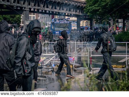 Landungsbruecken Hamburg - Germany July 7, 2017: Protesters Throw Stones On Riot Police During G20 S