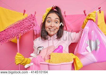 Housecleaning Service And Domestic Chores Concept. Positive Smiling Asian Woman Maid Poses With Garb