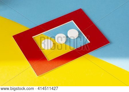 Macro Shot Of Three White Tablets In A Red Frame. Antacids Pills For Relief Stomachache From Excess