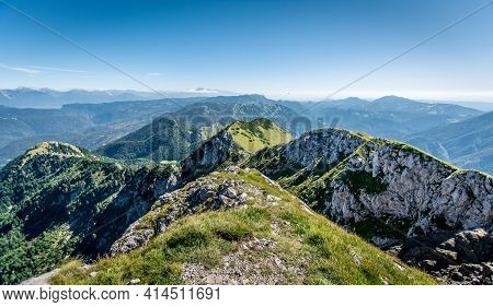 A Panoramic View On The Alps From The Top Of Mountain In Slovenia. Clear And Sunny Day. Sharp Peaks