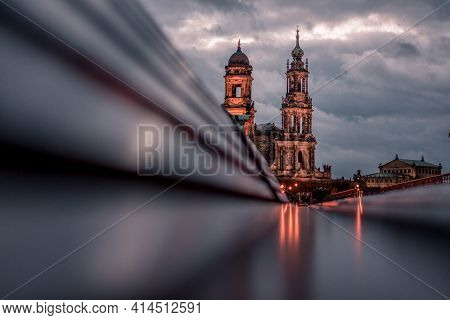 Dresden During Blue Hour, Reflection Of Sighs On Benches At Waterfront, Germany