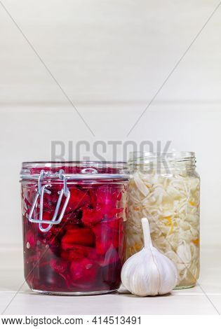 Homemade Sauerkraut With Carrot And Salad Cabbage With Beetroot On A Wooden Table. Fermented Food. C