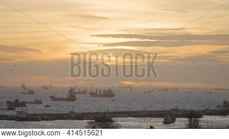 Beautiful Sea Horizon With Boats At Sunset. Action. Many Sea Vessels Float On Horizon With Sunset. B