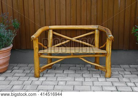 Beautiful Old Wooden Bench Is Standing On The Terrace At The House Wall